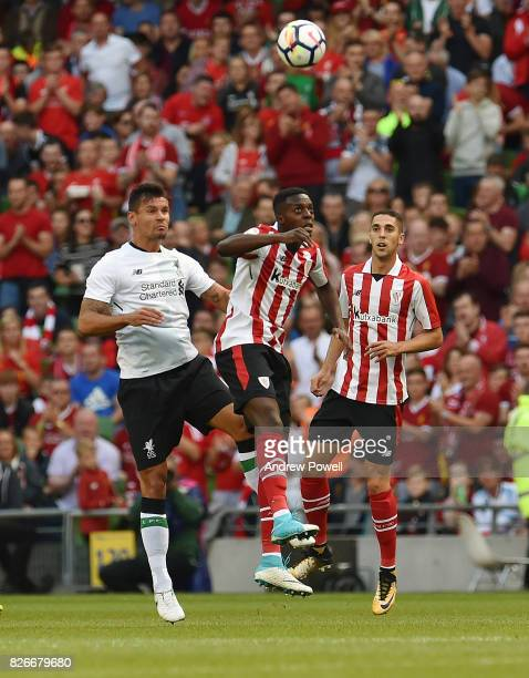 Dejan Lovren of Liverpool goes up with Sabin Merino of Athletic Bilbao during a pre season friendly match between Liverpool and Athletic Bilbao at...
