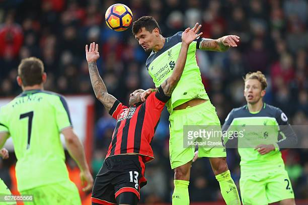 Dejan Lovren of Liverpool heads clear from Callum Wilson of Bournemouth during the Premier League match between AFC Bournemouth and Liverpool at the...