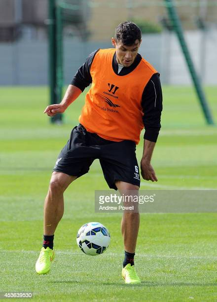 Dejan Lovren of Liverpool in action during a training session at Melwood Training Ground on August 15 2014 in Liverpool England