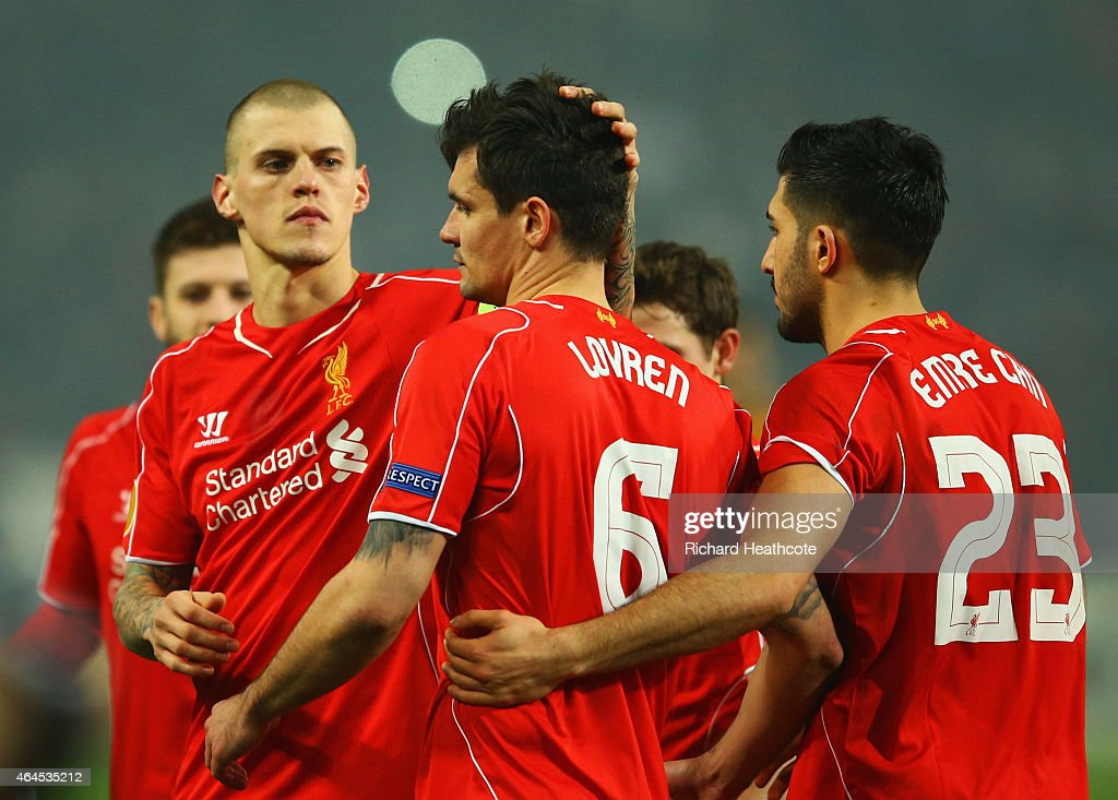 <a gi-track='captionPersonalityLinkClicked' href=/galleries/search?phrase=Dejan+Lovren&family=editorial&specificpeople=5577379 ng-click='$event.stopPropagation()'>Dejan Lovren</a> of Liverpool is consoled by <a gi-track='captionPersonalityLinkClicked' href=/galleries/search?phrase=Martin+Skrtel&family=editorial&specificpeople=5554576 ng-click='$event.stopPropagation()'>Martin Skrtel</a> (L) and <a gi-track='captionPersonalityLinkClicked' href=/galleries/search?phrase=Emre+Can&family=editorial&specificpeople=5909273 ng-click='$event.stopPropagation()'>Emre Can</a> (R) as he misses the decisive kick in the penalty shoot out during the UEFA Europa League Round of 32 second leg match between Besiktas JK and Liverpool FC on February 26, 2015 in Istanbul, Turkey.