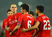Dejan Lovren of Liverpool is consoled by Martin Skrtel and Emre Can as he misses the decisive kick in the penalty shoot out during the UEFA Europa...