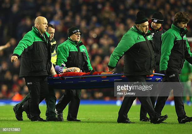Dejan Lovren of Liverpool is stretchered off during the Barclays Premier League match between Liverpool and West Bromwich Albion at Anfield on...