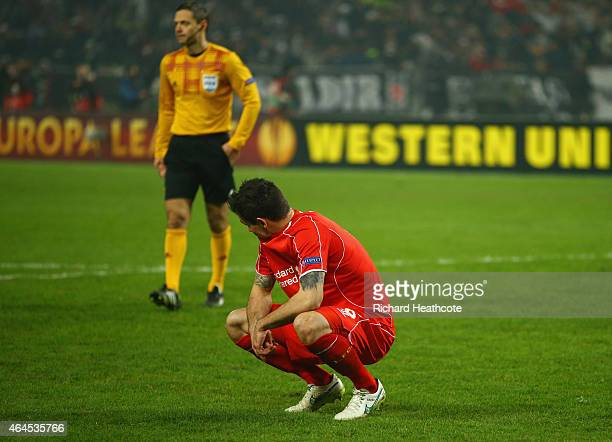 Dejan Lovren of Liverpool looks dejected as he misses the decisive kick in the penalty shoot out during the UEFA Europa League Round of 32 second leg...