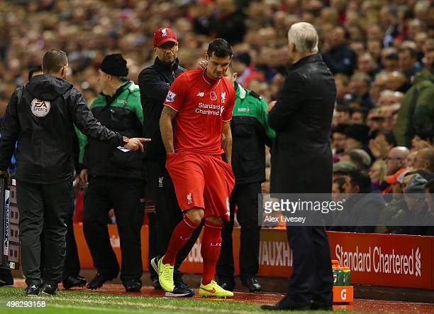 Dejan Lovren of Liverpool prepares to come on only for Jurgen Klopp Manager of Liverpool to tell him to sit down during the Barclays Premier League...