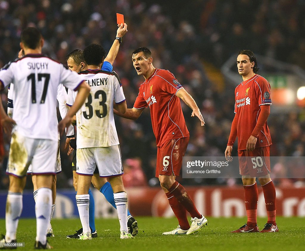 <a gi-track='captionPersonalityLinkClicked' href=/galleries/search?phrase=Dejan+Lovren&family=editorial&specificpeople=5577379 ng-click='$event.stopPropagation()'>Dejan Lovren</a> #6 of Liverpool reacts as teammate Lazar Markovic #50 of Liverpool is shown the red card card during the UEFA Champions League group B match between Liverpool and FC Basel 1893 at Anfield on December 9, 2014 in Liverpool, United Kingdom.
