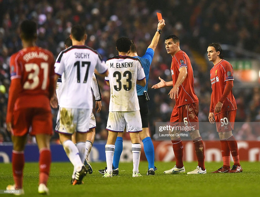 Dejan Lovren #6 of Liverpool reacts as teammate Lazar Markovic #50 of Liverpool is shown the red card card during the UEFA Champions League group B match between Liverpool and FC Basel 1893 at Anfield on December 9, 2014 in Liverpool, United Kingdom.