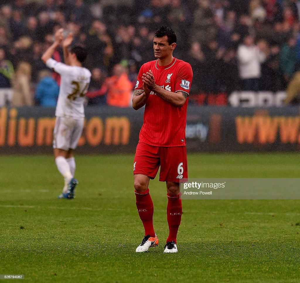 <a gi-track='captionPersonalityLinkClicked' href=/galleries/search?phrase=Dejan+Lovren&family=editorial&specificpeople=5577379 ng-click='$event.stopPropagation()'>Dejan Lovren</a> of Liverpool shows his appreciation to the fans at the end of the Premier League match between Swansea City and Liverpool at the Liberty Stadium on May 01, 2016 in Swansea, Wales.