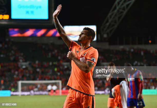 Dejan Lovren of Liverpool shows his appreciation to the fans at the end of the Premier League Asia Trophy match between Liverpool FC and Crystal...