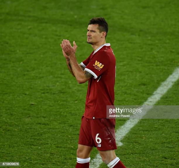 Dejan Lovren of Liverpool shows his appreciation to the fans at the end of the Premier League match between Liverpool and Southampton at Anfield on...