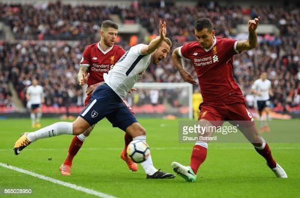 Dejan Lovren of Liverpool tackles Harry Kane of Tottenham Hotspur during the Premier League match between Tottenham Hotspur and Liverpool at Wembley...