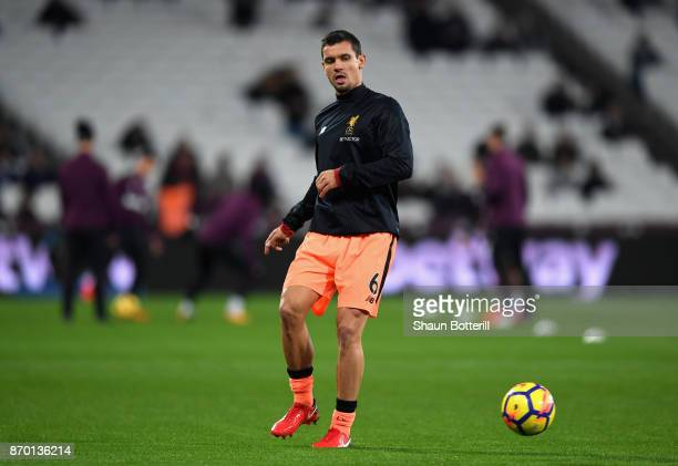 Dejan Lovren of Liverpool warms up prior to the Premier League match between West Ham United and Liverpool at London Stadium on November 4 2017 in...