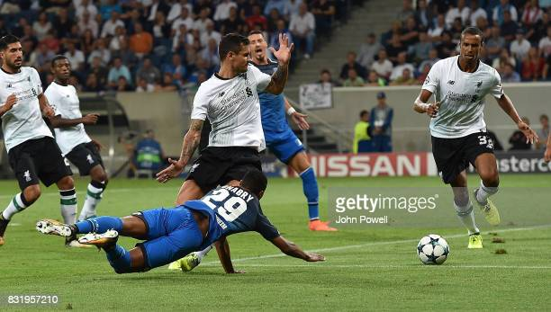Dejan Lovren of Liverpool with Serge Gnabry of TSG 1899 during the UEFA Champions League Qualifying PlayOffs Round First Leg match between 1899...