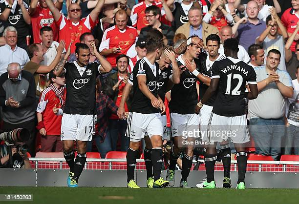 Dejan Lovren of Southampton celebrates his winning goal with his team mates during the Barclays Premier League match between Liverpool and...