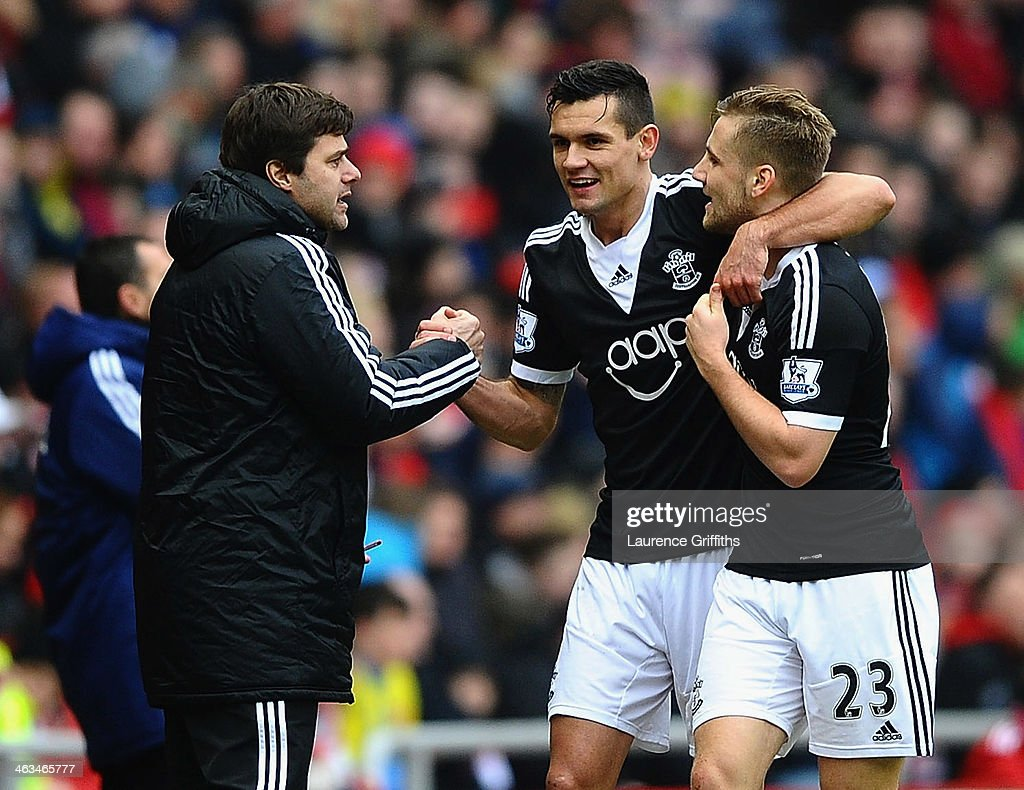 Dejan Lovren of Southampton (C) celebrates with Mauricio Pochettino manager of Southampton (L) and Luke Shaw (23) as he scores their second goal during the Barclays Premier League match between Sunderland and Southampton at Stadium of Light on January 18, 2014 in Sunderland, England.