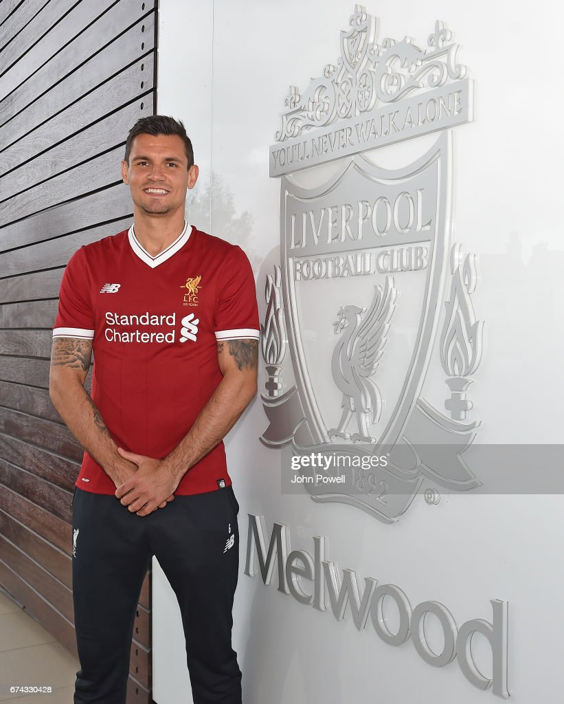Dejan Lovren poses as he signs a new four-year contract with Liverpool FC at Melwood Training Ground on April 27, 2017 in Liverpool, England.