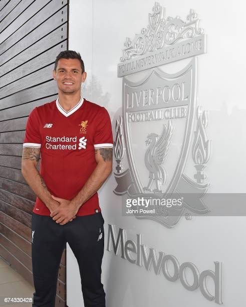Dejan Lovren poses as he signs a new fouryear contract with Liverpool FC at Melwood Training Ground on April 27 2017 in Liverpool England