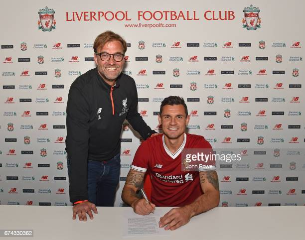Dejan Lovren poses with manager Jurgen Klopp as he signs a new fouryear contract with Liverpool FC at Melwood Training Ground on April 27 2017 in...