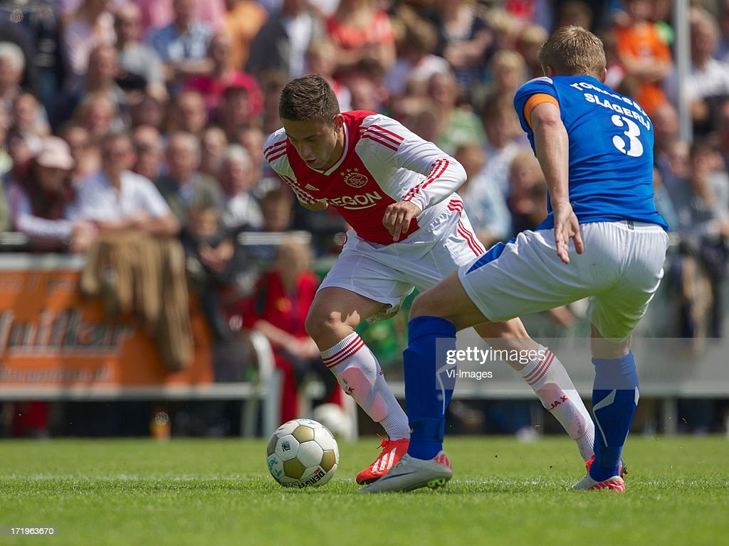 Dejan Meleg of Ajax, Richard Gooijer of SDC Putten during the pre season friendly match between SDC Putten and Ajax on June 29, 2013 in Putten, The Netherlands.