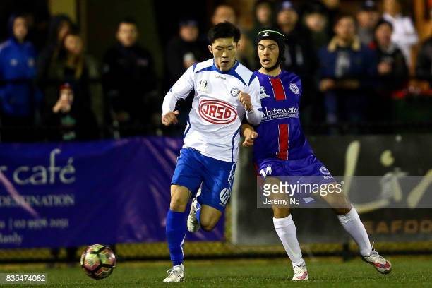 Dejan Pandurevic of Manly United and Jinya An of Sydney Olympic challenge for the ball during the NSW NPL 1 Elimination Final between Manly United FC...