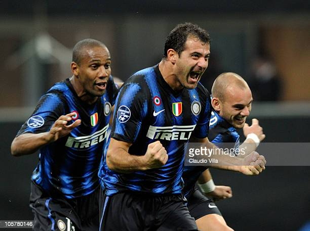 Dejan Stankovic Maicon and Wesley Sneijder of FC Internazionale Milano celebrate the third goal during the UEFA Champions League group A match...