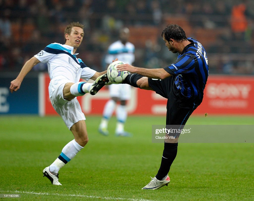 <a gi-track='captionPersonalityLinkClicked' href=/galleries/search?phrase=Dejan+Stankovic&family=editorial&specificpeople=242949 ng-click='$event.stopPropagation()'>Dejan Stankovic</a> of FC Inter Milan and M<a gi-track='captionPersonalityLinkClicked' href=/galleries/search?phrase=Benoit+Pedretti&family=editorial&specificpeople=714997 ng-click='$event.stopPropagation()'>Benoit Pedretti</a> (L) of LOSC Lille Metropole compete for the ball during the UEFA Champions League, group B match between FC Internazionale Milano and LOSC Lille Metropole at Giuseppe Meazza Stadium on November 2, 2011 in Milan, Italy.