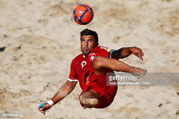 Dejan Stankovic of Switzerland attempts a scissor kick shot on goal during the Group B FIFA Beach Soccer World Cup match between Switzerland and...