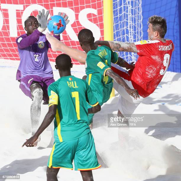 Dejan Stankovic of Switzerland tries to score against goalkeeper Abdoul Samba Papa Ndour and Babacar Fall of Senegal during the FIFA Beach Soccer...