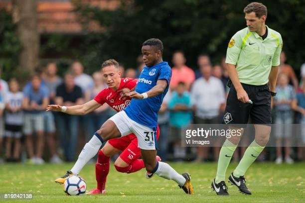 Dejan Trajkovski of FC Twente Ademola Lookman of Everton FC referee Jochem Kamphuis during the friendly match between FC Twente and Everton FC at...
