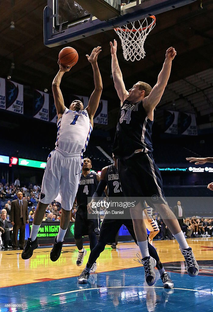 DeJaun Marrero #1 of the DePaul Blue Demons shoots against Nate Lubick #34 of the Georgetown Hoyas at the Allstate Arena on February 3, 2014 in Rosemont, Illinois. Georgetown defeated DePaul 71-59.