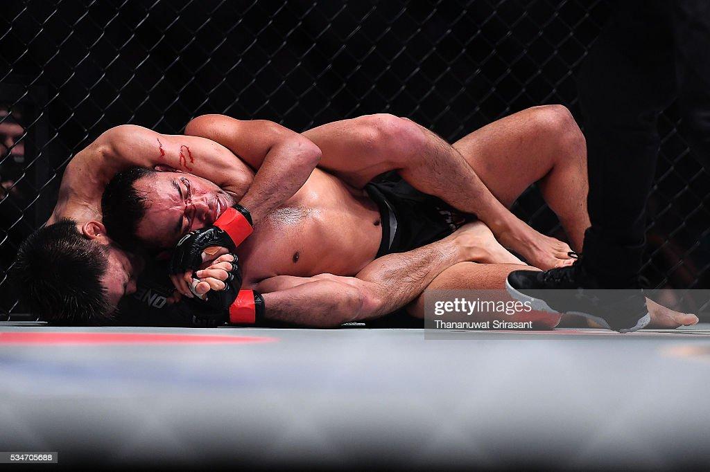 Dejdamrong Sor Amnuaysirichoke of Thailand and Yoshitaka Naito of Japan in the strawweight bouts during the OneFC Kingdom of Champions on May 27, 2016 in Bangkok, Thailand.