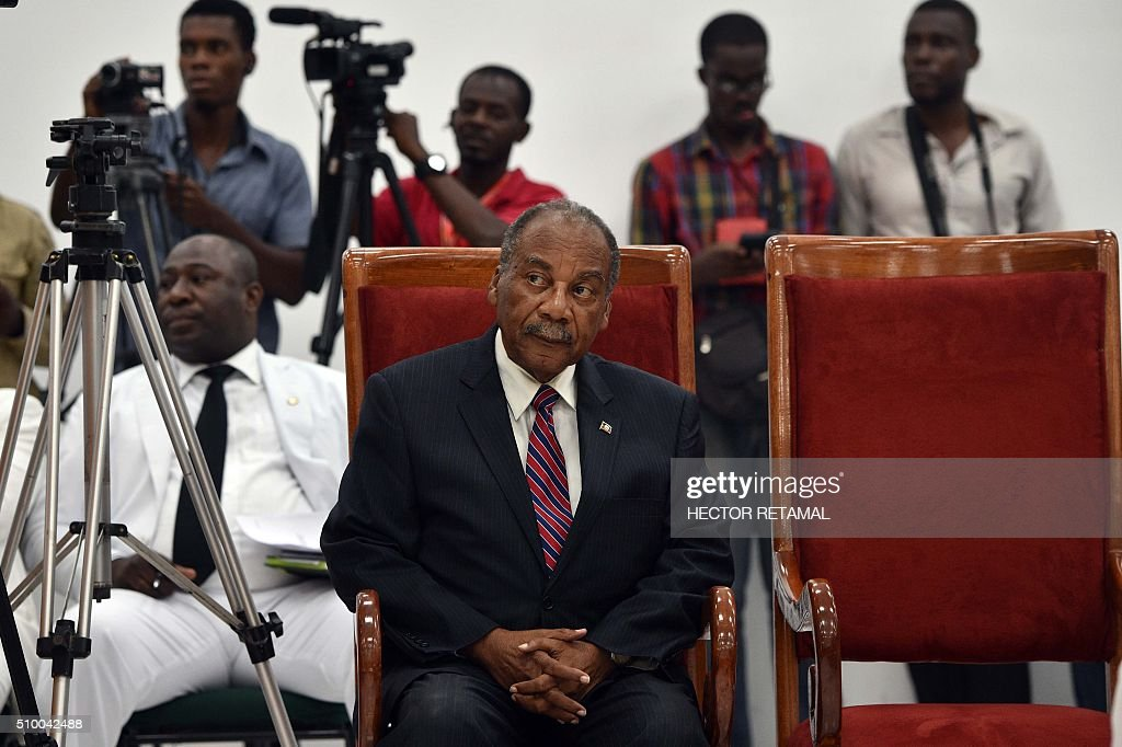 Dejean Belezaire, candidate to be provisional president, listens as Haitian lawmakers prepare to elect an interim president on February 13, 2016 at the Haitian Parliament in Port-au-Prince. Haitian lawmakers were set to elect an interim president to fill the power vacuum following the departure of Michel Martelly, after a vote to choose his replacement was postponed over fears of violence. Thirteen candidates applied to run in the election but only three paid the fee of 500,000 gourdes (about $8,400) and will participate. RETAMAL