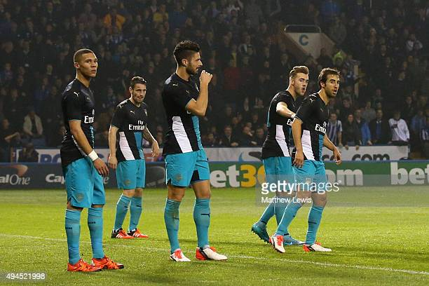 Dejeceted Arsenal players look on during the Capital One Cup fourth round match between Sheffield Wednesday and Arsenal at Hillsborough Stadium on...