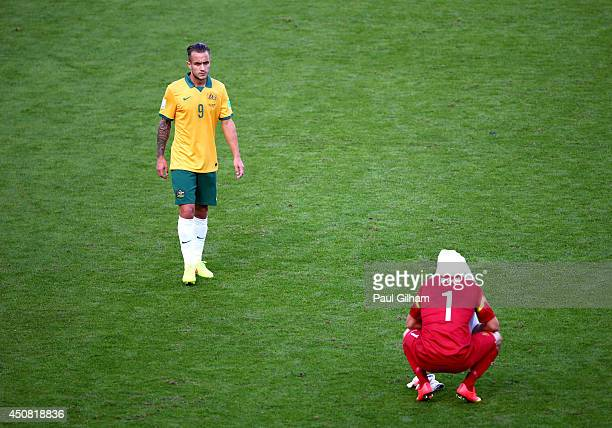 A dejected Adam Taggart and Mathew Ryan of Australia look on after being defeated by the Netherlands 32 during the 2014 FIFA World Cup Brazil Group B...