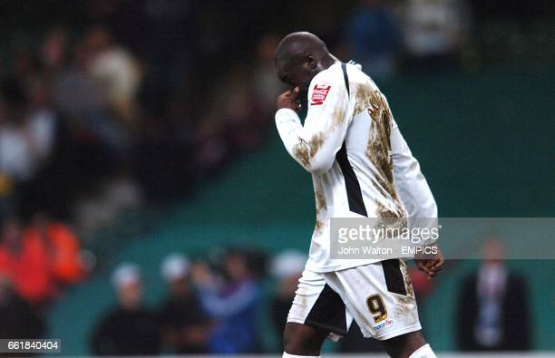 A dejected Adebayo Akinfenwa Swansea City walks back to the centre circle after missing his penalty