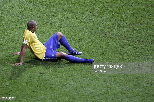 A dejected Adriano of Brazil sits on the pitch following his team's 10 defeat and exit from the competition during the FIFA World Cup Germany 2006...