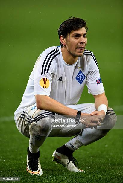 A dejected Aleksandr Dragovic of Dynamo Kyiv looks on folowing his team's 21 defeat during the UEFA Europa League Round of 16 first leg match between...
