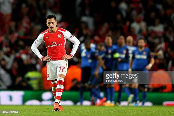 A dejected Alexis Sanchez of Arsenal reacts after his team concede a second goal during the UEFA Champions League round of 16 first leg match between...