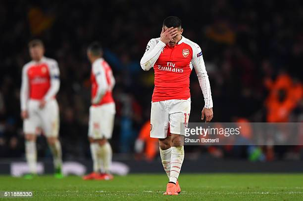 A dejected Alexis Sanchez of Arsenal reacts during the UEFA Champions League round of 16 first leg match between Arsenal FC and FC Barcelona at the...