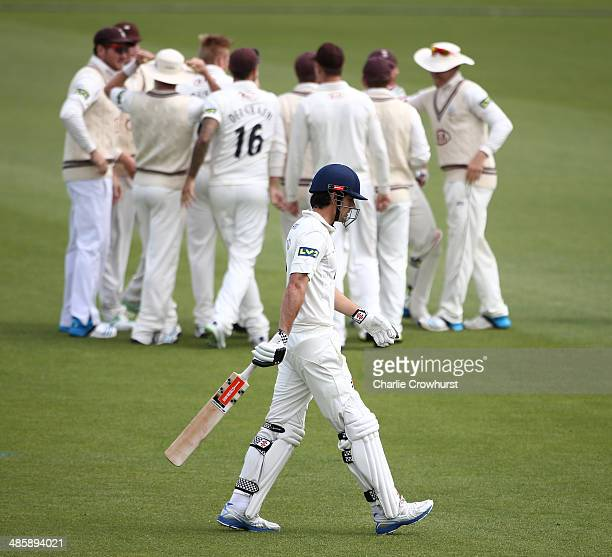 A dejected Alister Cook of Essex walks off after being caught out by Steven Davies of Surrey off the bowling from Matthew Dunn during day two of the...