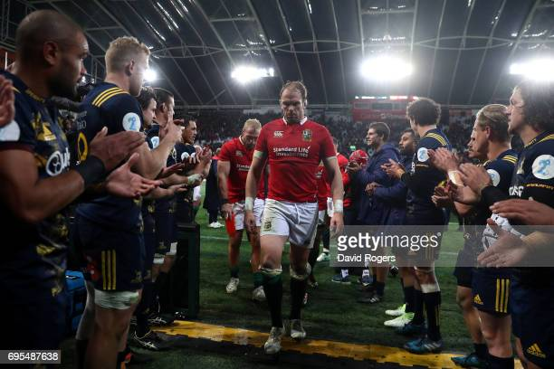 A dejected Alun Wyn Jones of the Lions and teammates walk off the pitch following their 2322 defeat during the 2017 British Irish Lions tour match...