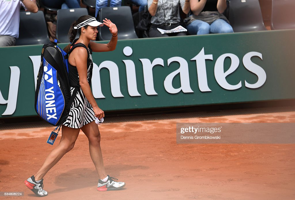 A dejected <a gi-track='captionPersonalityLinkClicked' href=/galleries/search?phrase=Ana+Ivanovic&family=editorial&specificpeople=542118 ng-click='$event.stopPropagation()'>Ana Ivanovic</a> of Serbia walks off the court following her defeat during the Ladies Singles third round match against Elina Svitolina of Ukraine on day seven of the 2016 French Open at Roland Garros on May 28, 2016 in Paris, France.