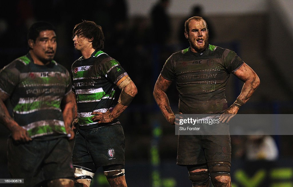 Dejected and muddied London Irish players Alex Gray (c) and Matt Garvey (r) look on at the final whistle after a narrow defeat during the LV= Cup match between Cardiff Blues and London Irish at the Arms Park on February 1, 2013 in Cardiff, Wales.
