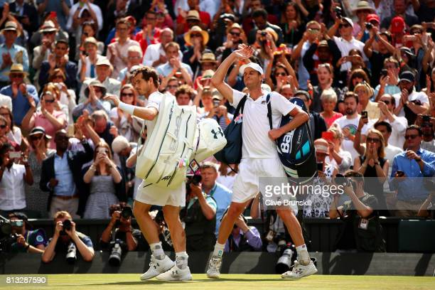 A dejected Andy Murray of Great Britain acknowledges the crowd as Sam Querrey of The United States celebrates after the Gentlemen's Singles quarter...