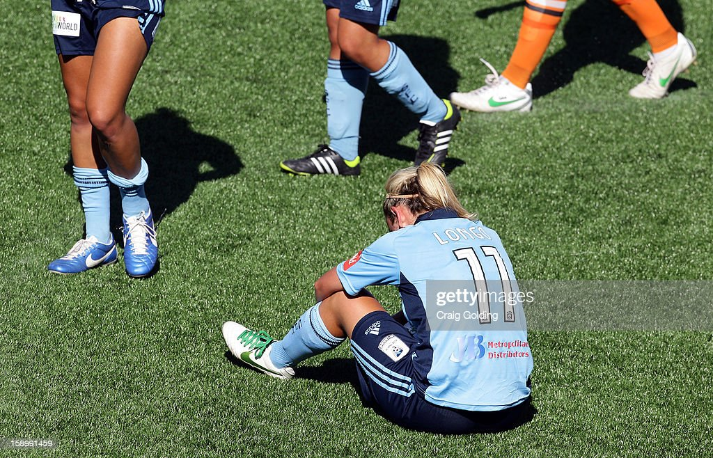 A dejected Annalie Longo at full time of the round 11 W-League match between Sydney FC and the Brisbane Roar on January 5, 2013 in Sydney, Australia.