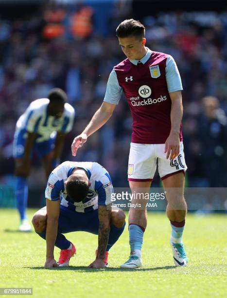 A dejected Anthony Knockaert of Brighton Hove Albion at full time with Jack Grealish of Aston Villa after the Sky Bet Championship match between...