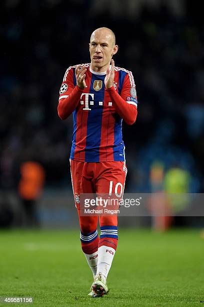 A dejected Arjen Robben of Bayern Muenchen applauds the travelling fans following his team's 32 defeat during the UEFA Champions League Group E match...
