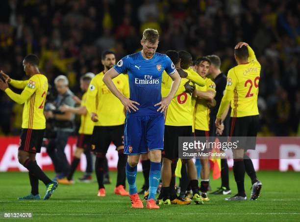 Dejected Arsenal captain Per Mertesacker after the Premier League match between Watford and Arsenal at Vicarage Road on October 14 2017 in Watford...