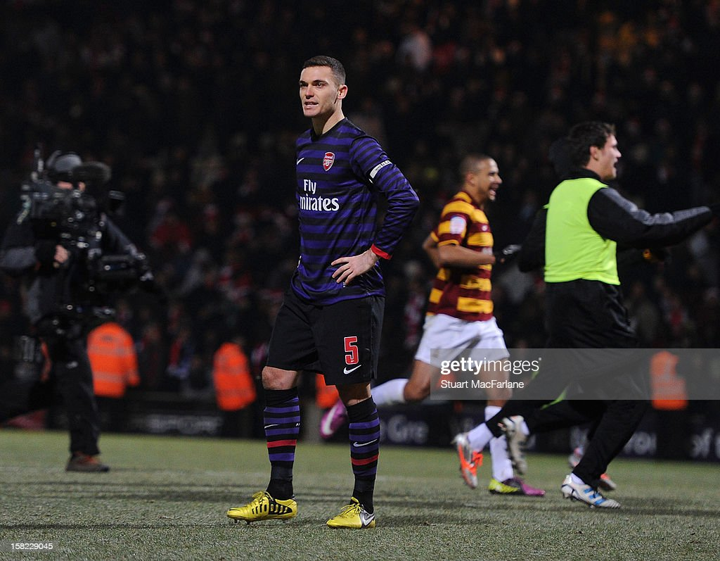 Dejected Arsenal captain Thomas Vermaelen after missing a penalty on the shoot out during the Capital One Cup match between Arsenal and Bradford City at Coral Windows Stadium, Valley Parade on December 11, 2012 in Bradford, England.