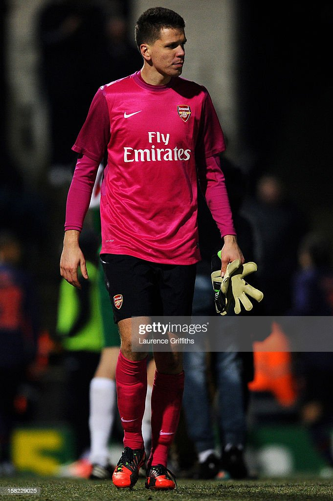 Dejected Arsenal goalkeeper Wojciech Szczesny looksm on following his team's defeat on penalties during the Capital One Cup quarter final match between Bradford City and Arsenal at the Coral Windows Stadium, Valley Parade on December 11, 2012 in Bradford, England.