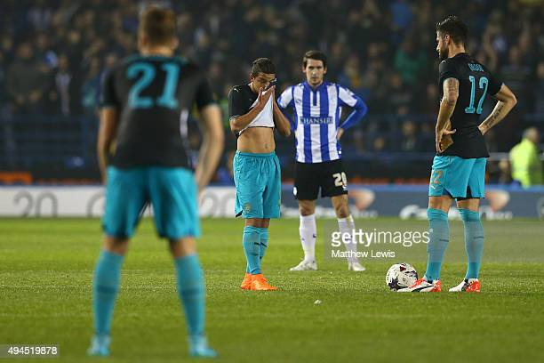 Dejected Arsenal players look on after conceding the opening goal during the Capital One Cup fourth round match between Sheffield Wednesday and...